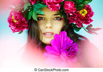 Spring time - Beautiful woman with bright flowers looking at...