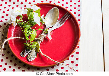 Spring time table setting with rustic plates and cherry...