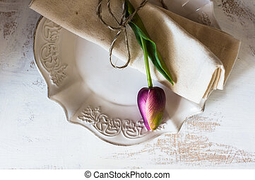 Spring time table setting with tulip flowers and vintage...
