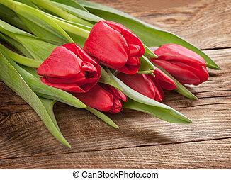 Spring tulip on the oldboard