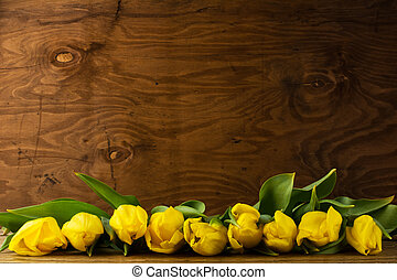 Spring tulips bouquet on wooden background, copy space