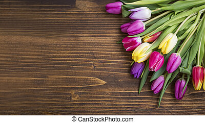 Spring tulips bouquet on wooden background with copy pace, spring greeting
