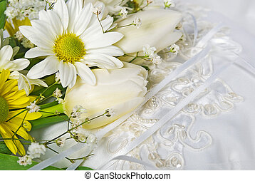 Spring Wedding - Tulip and daisy bouquet on satin wedding...