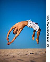 springende , junger mann