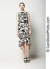 Springtime Collection. Elegant Slender Woman in Stylish Dress. Trendy Fashion Model