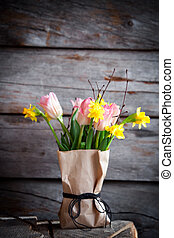 Springtime flower bouquet with tulips and daffodils