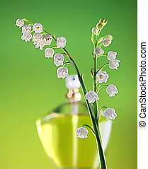 Springtime fragrance - Bottle of perfume and two twigs of...