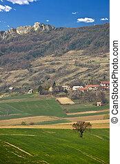 Springtime green landscape - meadow and mountain, Kalnik,...