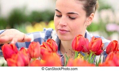 springtime, smiling woman in garden