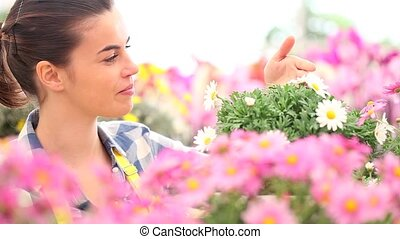 springtime smiling woman smells the