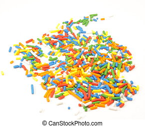 Sprinkes spilled - Candy sprinkles spilled on a white...