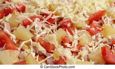 sprinkle pineapple pizza with parmesan. High quality 4k footage