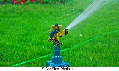 Sprinkler system head spreading water slomo - Sprinkler...