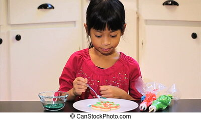 Sprinkling Christmas Cookies - A cute little 6 year old...