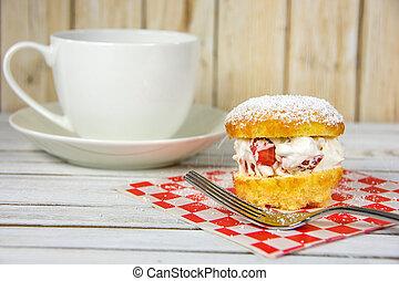 sprinkling powdered sugar on petite cake - petite cake with...