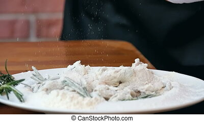 Sprinkling salt all over fresh seafood with flour