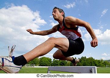 sprinter, biegnie przez płotki