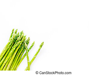 Sprout of fresh asparagus on white background top view copyspace