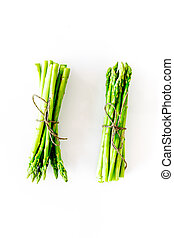 Sprout of fresh asparagus on white background top view