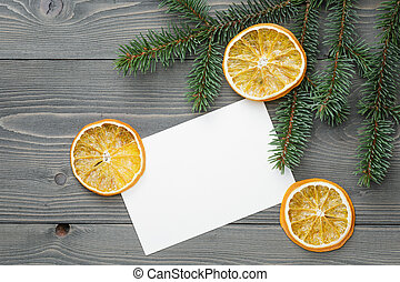 spruce twig with dried orange slices and greeting card