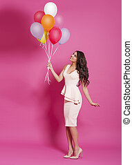 sprytny, młoda kobieta, z, balony