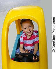 sprytny, mały chłopieją, wóz, uśmiechanie się, interpretacja