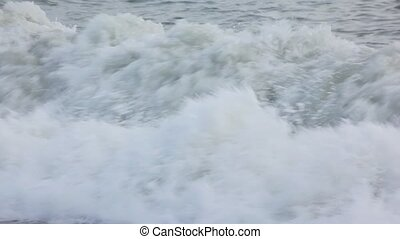 spumous surfing waves of sea
