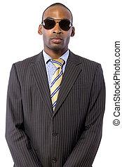 Spy / Bodyguard - African American spy or bodyguard in a...