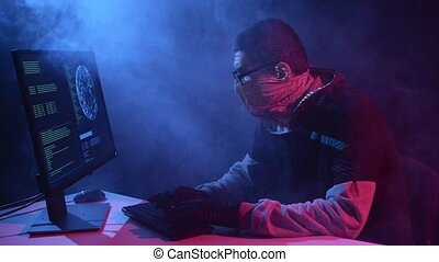 Spy enters virus data into the computer. Black smoke...