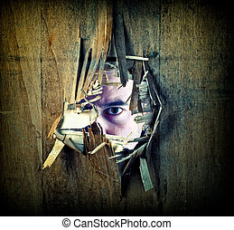spy from the hole - broken grunge wood and caucasina man...