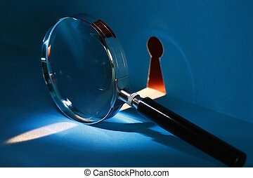 Spy Through Keyhole - Spying concept. Magnifying glass near...