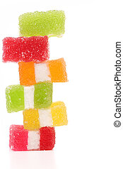 Spyral colorful jelly candies on a white background.