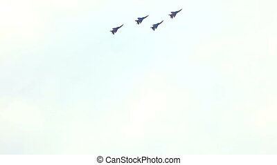 squad of fighters jet fly in row