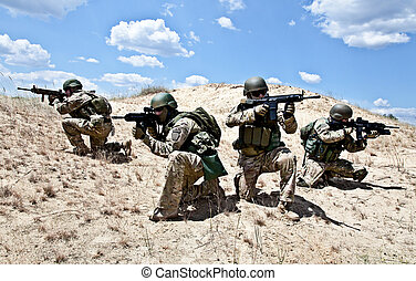 military operation - Squad of soldiers in the desert during ...