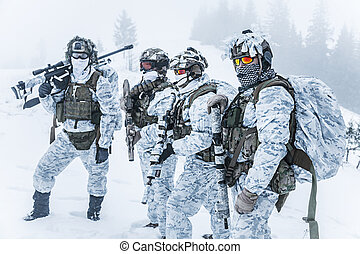 Squad of soldiers in winter forest