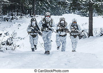 Squad of soldiers in winter forest - Winter arctic mountains...