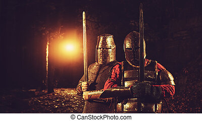 Squad of two medieval knights on the night rural background