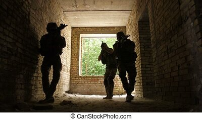 Squad sneaking up to enemy in occupied building - Group of...