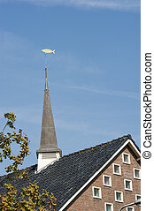Square belfry with fish weather vane