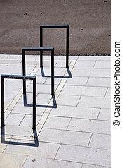 Square bike racks cast shadows
