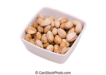 Square bowl of pistachios on white background