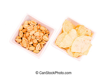 Square bowls of pretzels on a white background seen from above
