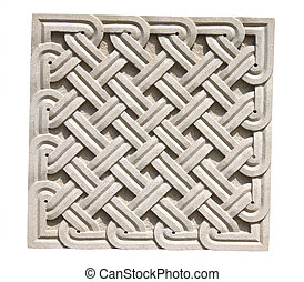 Square braided stone ornament. Old stone wall detail with decorative pattern