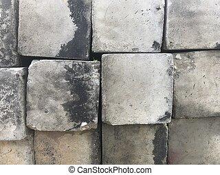 square cement blocks left outdoor in full frame shot