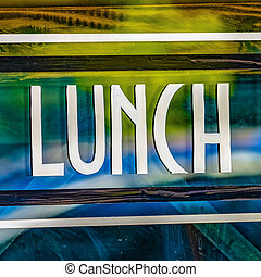 Square Close up view of a Lunch sign against the glass wall of a restaurant