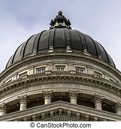 Square crop Dome and pediment of Utah State Capital building in Salt Lake City against sky