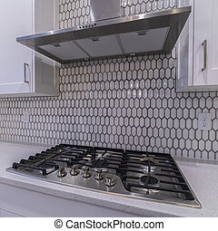 Square crop Modern cooker hob and extractor fan interior