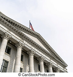 Square crop Pedimented entrance of historic Utah State Capital building in Salt Lake City