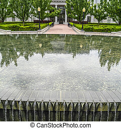 Square crop Water fountain with pool against building and trees in Salt Lake City Utah