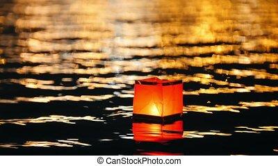 Square floating lighting Lanterns on river at night -...